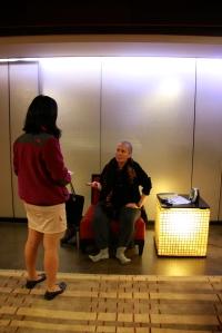 Ji Hyang Padma speaking to student  Hannah Degner '15